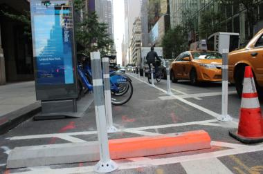 A man was knocked into unconscious when he rode his Citi Bike into a newly installed barrier at East 56th Street and Madison Avenue, witnesses and officials said.