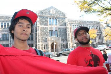 Two City College students who led protests against the closure of a student-run community room have been suspended indefinetely after officials accussed them of trying to incite a riot.