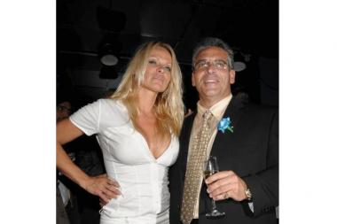 Glen Bernardi, right, with Pamela Anderson, at the opening of the Sapphire strip club in 2009.