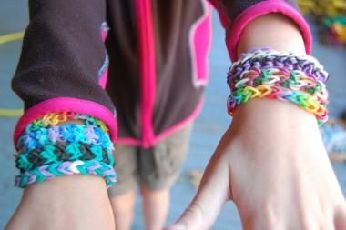 Kids make Rainbow Loom bracelets using tiny colored rubber bands. The toy is wildly popular, but it was so distracting that Park Slope's P.S. 107 recently banned it. The bracelets however are still allowed at school.