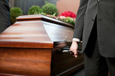 Ex-funeral director Richard Santiago filed a lawsuit accusing his boss of talking about male cadaver's private parts.