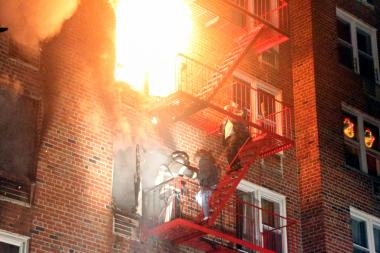 Nearly 170 firefighters battled a massive fire that erupted in a Kew Gardens home Tuesday, the FDNY said.