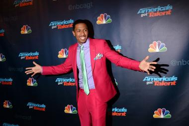 """America's Got Talent"" host Nick Cannon at the show's Radio City Music Hall red carpet event in August 2013."