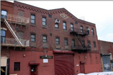 A former Pencil Factory building next to Kickstarter's headquarters is now up for sale.