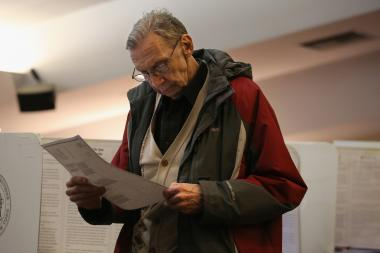 A voter studies his completed ballot at a polling station on November 5, 2013 in Brooklyn.