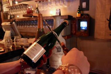 At The Baroness, customers can learn how to ceremoniously open their bubbly with a blade.