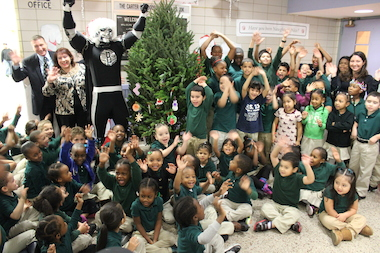 Students at P.S. 23 in Bed-Stuy celebrate the holidays with the BrooklynKnight, the Nets' mascot. The school's staff is reaching out to the community for help in throwing a carnival for the kids.