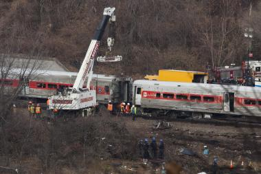 Investigators pored over a derailed Metro-North train in The Bronx.