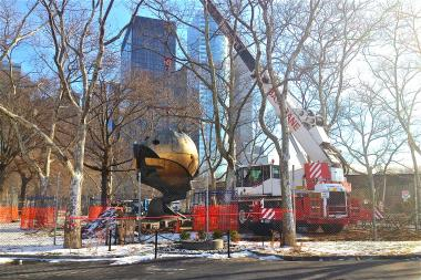 The iconic bronze Fritz Koening sphere was moved to a new location in Battery Park.