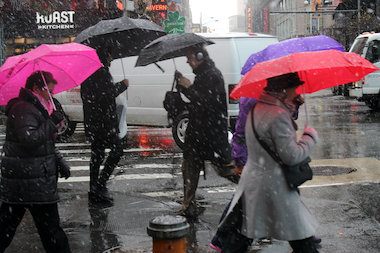 Snow fell in New York City Tuesday, in the first big snowfall of the winter.