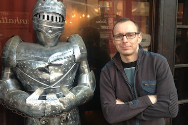 Chef Krzysztof Drzewiecki with one of the knights outside his Manhattan Avenue restaurant, Krolewskie Jadlo.