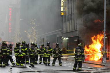 A manhole explosion that sent smoke and flames into the air caused the partial evacuation of a building.