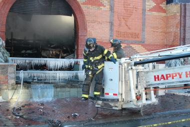 A Greenpoint lumberyard burned for five hours while firefighters fought the bitter cold and heavy winds to put it out.