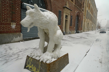 The massive piece of art depicts a crouching wolf with sharp claws outside the former home of the ASPCA.