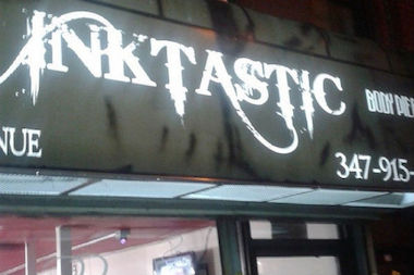Police say a woman was raped inside Inktastic on Ralph Avenue in Bed-Stuy during an armed robbery.