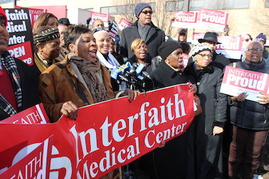 Protestors staged a rally outside of Interfaith Medical Center on Jan. 19. Sharonnie Perry (center, behind microphones) and IM Foundation Chair Diane Porter (not pictured) will be honored with a public health award.