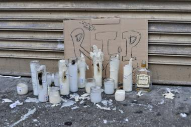 Calvern Wallace, 33, was fatally shot in the face in Harlem bar PJ's Cocktail Lounge and Restaurant on Jan. 8, 2014. Family and friends erected a makeshift memorial in front of the shuttered bar.