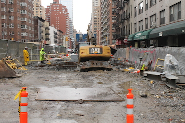 A construction crew works on the Second Avenue Subway project on 69th Street. The MTA plans to temporarily take over four properties as part of its construction.