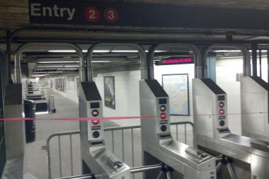 A person was injured as they raced for a train in the Wall Street station, the MTA said.