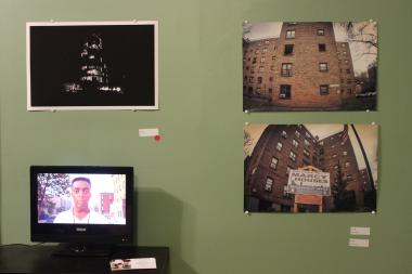 "Pieces in the Warehouse Gallery include (clockwise from top left) ""Black and White"" by Kamau Ware, and ""Window Shopping"" and ""Cough Up A Lung"" by Brock Mills. Spike Lee's ""Do the Right Thing"" plays on a small television during the gallery's hours."
