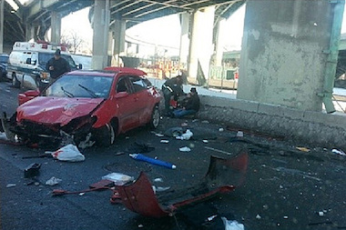 A man and woman survived after their car fell off the Bruckner Expressway to a service road below on Feb. 10, 2014.