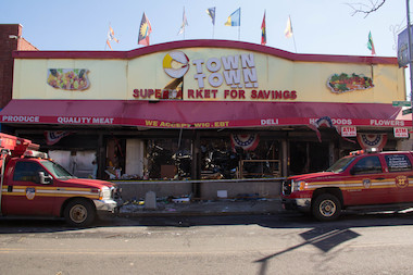 A huge fire tore through three businesses in Port Richmond, including a C-Town Supermarket.
