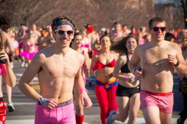 Cupid's Undie Run has nearly naked participants run a mile to raise money for charity.