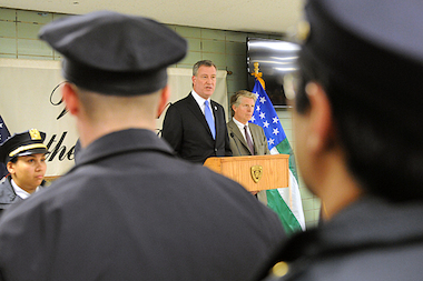 Bill de Blasio, standing next to Manhattan District Attorney Cyrus Vance, speaks with officers at the 25th precinct during their roll call Thursday afternoon, Feb. 27, 2014.