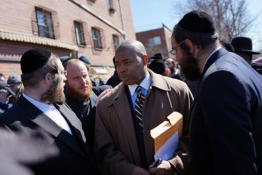 Brooklyn Borough President Eric Adams with members of the Brooklyn Orthodix Jewish community in March 2013.