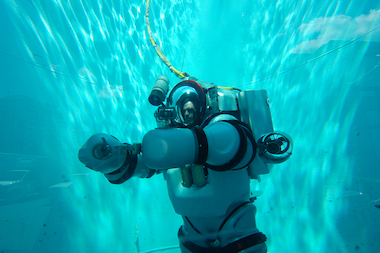 The suit allows the wearer to stay at the same atmospheric pressure as the surface but to plunge to depths of 1,000 feet below sea level.