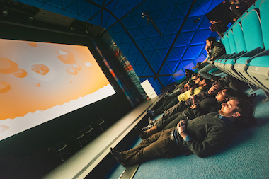 "Attendees play a round of Fernando Ramallo's ""Panoramical"" during the Night Games portion of the festival IndieCade East."