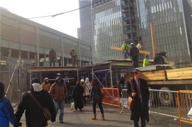Port Authority is constructing a temporary sidewalk shed in front of the WTC PATH station to help protect against ice fall from 1 WTC.