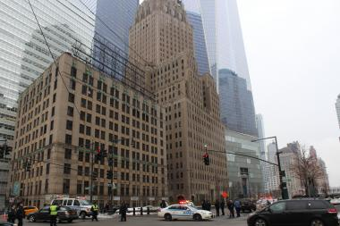 Parts of West Street were shut down Wednesday morning after ice fell from the new Freedom Tower.