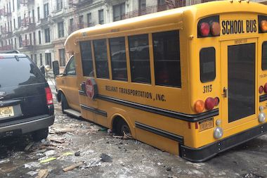 A school bus got stuck in a sinkhole in Washington Heights.