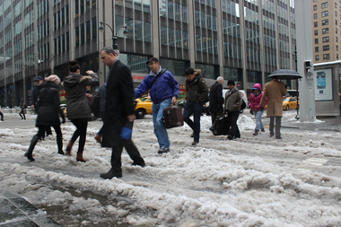 Midtown travelers passed through slush and ankle-deep puddles on Wednesday morning, Feb. 5, 2014.