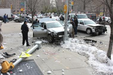 A stolen car crashed into two light poles and another car at Buschwick Avenue and Siegel Street on Wednesday.