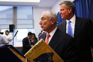 "Bill Bratton reading to the press from ""Your Police"" the day Mayor Bill de Blasio announced his appointment as police commissioner."