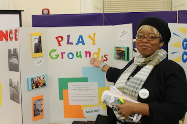 Theresa Davis displays her poster, which describes playgrounds in NYCHA houses that are in need of repair, at District 33's Participatory Budgeting Project Expo. Davis' proposal won the most votes, and will be funded.