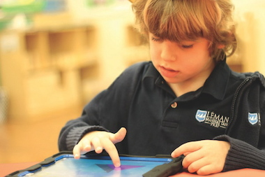 A student from Léman Manhattan Preparatory School with an iPad. The Downtown private school is one of many that will make the ERB optional for kindergarten admissions based on the recommendations of the Independent Schools Admissions Association of Greater New York.