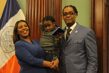 Four-year-old Symeir Talley-Jasper, held in this photo by Public Advocate Letitia James, left his Bed-Stuy school unattended in January. Robert Cornegy, right, introduced a bill in the City Council to outfit school exits with an alarm system.