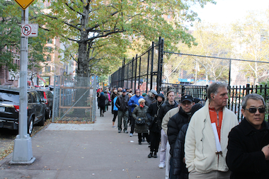 Voters line up to vote at P.S. 87 on Election Day. Parents have said the influx of strangers in schools during Primary Day is dangerous.