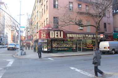 A woman who was stopped by officers outside University Place Gourmet Deli bit one of them, police said.