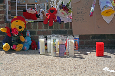 Neighbors lit candles for 4-year-old Jai'Launi Tinglin and Aniya Tinglin.