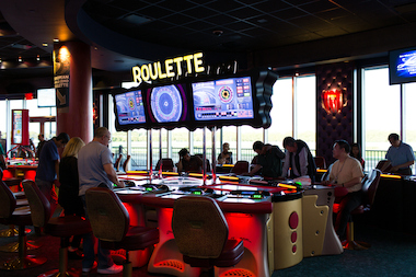 A Resorts World employee was knocked unconscious when a roulette machine fell on her head, a lawsuit charges.
