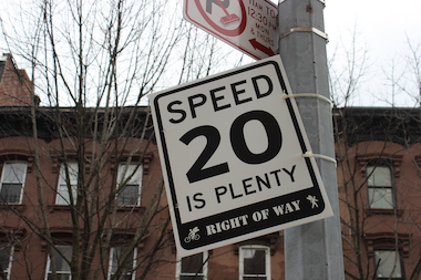 Slow zone advocates put up fake 20 mph signs in Bed-Stuy.