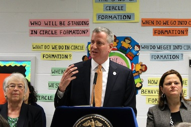 Mayor Bill de Blasio, flanked by Schools Chancellor Carmen Fariña and City Council Speaker Melissa Mark-Viverito, announced the first wave of new full-day universal pre-kindergarten seats at a school in Queens on April 2, 2014.