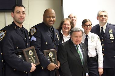 "The 112th Precinct Community Council presented two officers with ""Cop of the Month"" award during its meeting on Thursday, April 24. Pictured from left are: P.O. Frank Nappi; Sgt. Eduardo Roche; 112th Precinct Community Council President Heidi Chain, Queens District Attorney Richard Brown; Lt. Brian Goldberg; Chief Diana Pizzuti and Capt. Thomas Conforti, the precinct's commanding officer."
