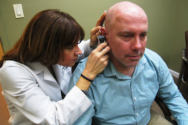 Dan Moynihan, a former volunteer firefighter and 9/11 first responder, lost his hearing after surgery on a tumor resulting from Ground Zero-related illness. Dr. Alison Hoffman donated a state-of-the-art hearing aid earlier this year.