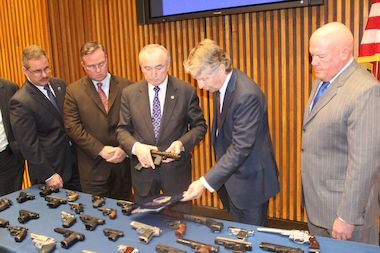 NYPD Commissioner Bill Bratton and Manhattan District Attorney Cyrus Vance announced the arrests of two men who sold guns to undercover police officers.