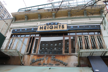 The Heights bar is opening with an altered menu and higher ceilings after a fire at a Citibank next door forced it to close for repairs for more than three months.